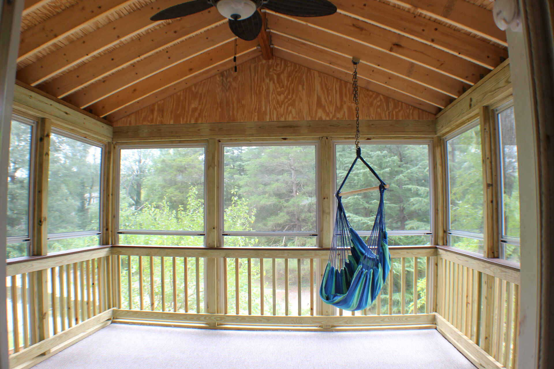 Screened-In Porch with a Hanging Hammock Chair